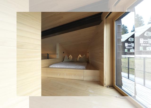 sypialnia w czarnym domku (Ferienhaus Girardi by Philip Lutz)
