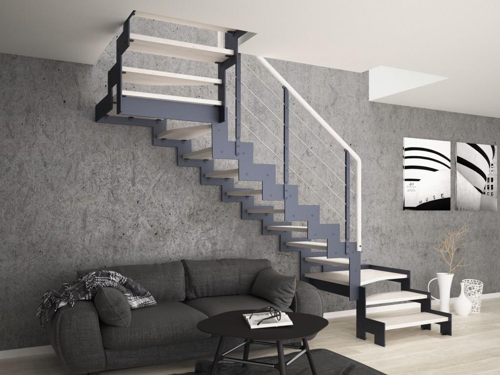 Schody Monolama, oparte na konstrukcji metalowej, malowanej proszkowo na kolor grafitowy, ze stopniami wykonanymi z bielonej mozaiki bukowanej oraz metalową.
