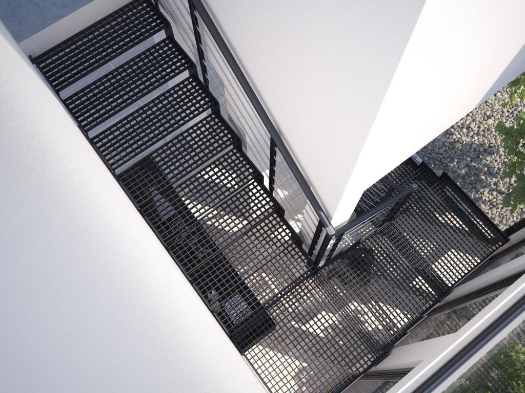 Schody Monolama w czarnej kolorystyce, oparte na malowanej proszkowo konstrukcji metalowej, ze stopniami z kratki metalowej oraz metalową poręczą Filo
