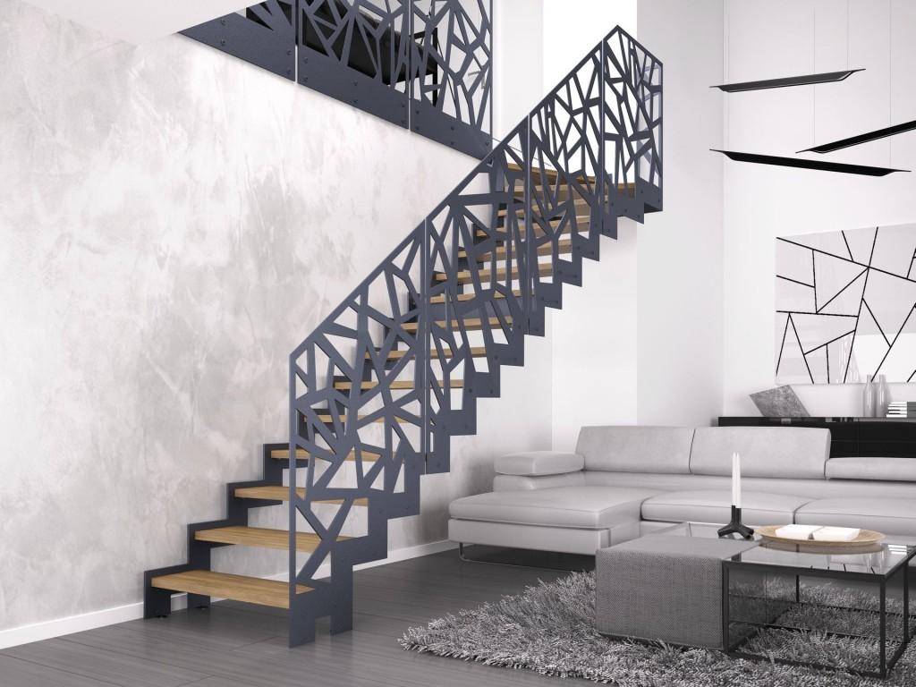 Schody Monolama, oparte na konstrukcji metalowej, malowanej proszkowo na kolor grafitowy, z dębowymi stopniami w kolorze natury oraz metalową balustradą z wycinanymi laserowo wzorami.