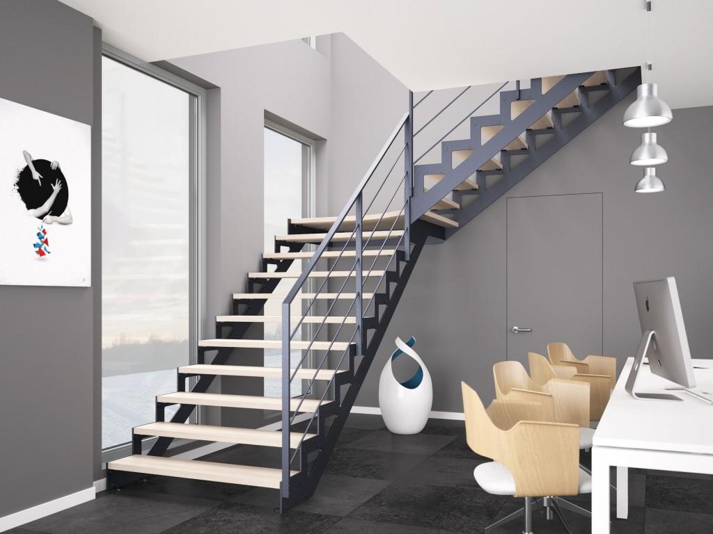 Schody Stilo, oparte na konstrukcji metalowej, malowanej proszkowo na kolor grafitowy, ze stopniami wykonanymi z bielonej mozaiki bukowanej oraz balustradą Weld.